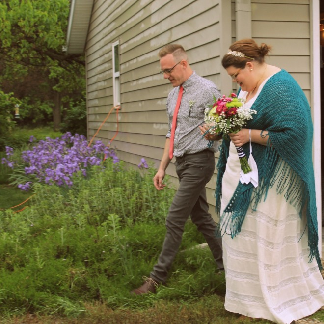 Here's an obligatory wedding photo of us walking one another down the aisle.
